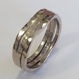 18kt white gold hammered and shaped wedding ring