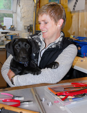 Jo and Izzi, the dog, in the jewellery studio