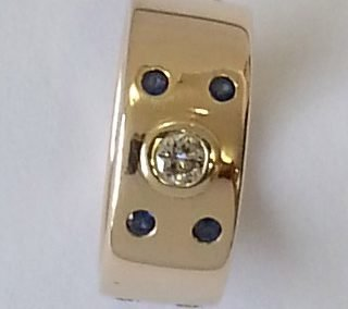 9kt yellow gold ring with flush set diamonds and sapphires 1