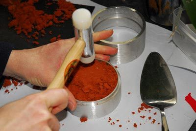 Packing the delft clay tightly with a hammer