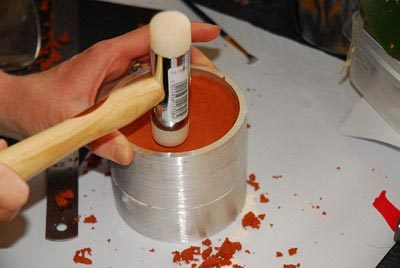 Hammer the top layer of delft clay.