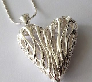 Fine silver hollow heart pendant with fixed triangular bail lazy loops
