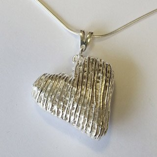 Fine silver hollow heart pendant with mobile triangular bail ~ criss cross