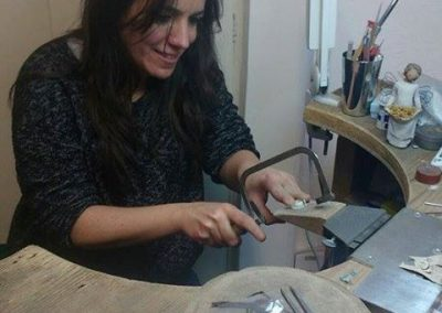 Paz cutting silver with a hand saw