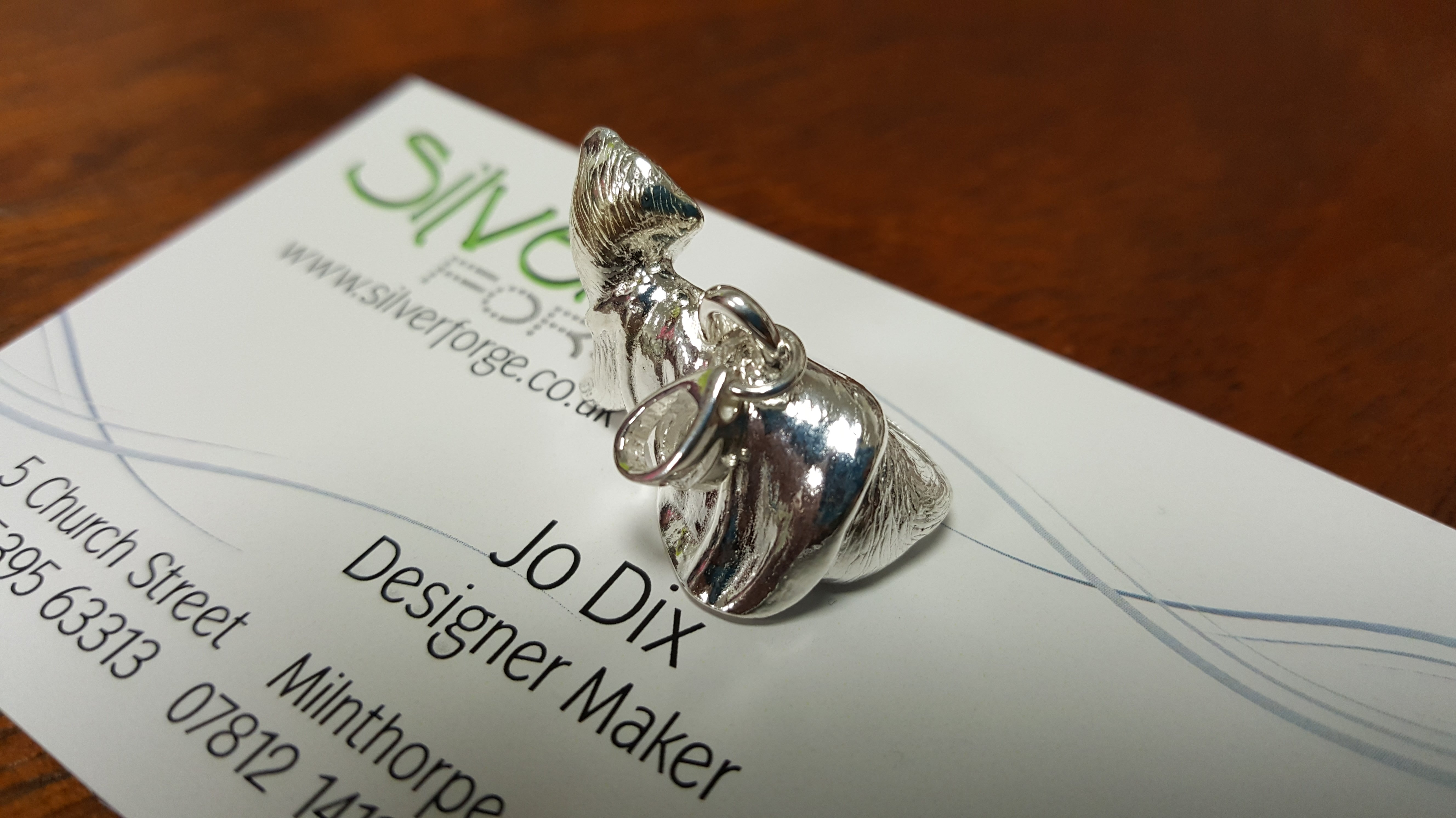 sterling silver ferret pendant back