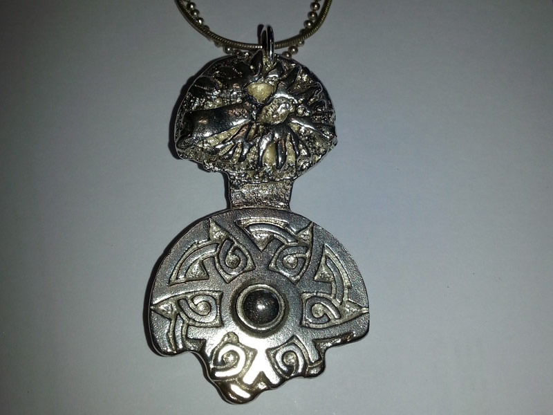 cast mayan pendant made by a student